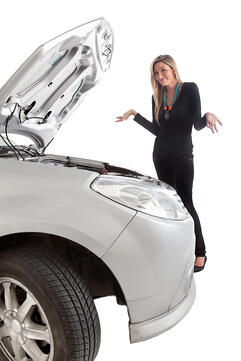 Woman having car trouble with an opened hood - isolated over a white